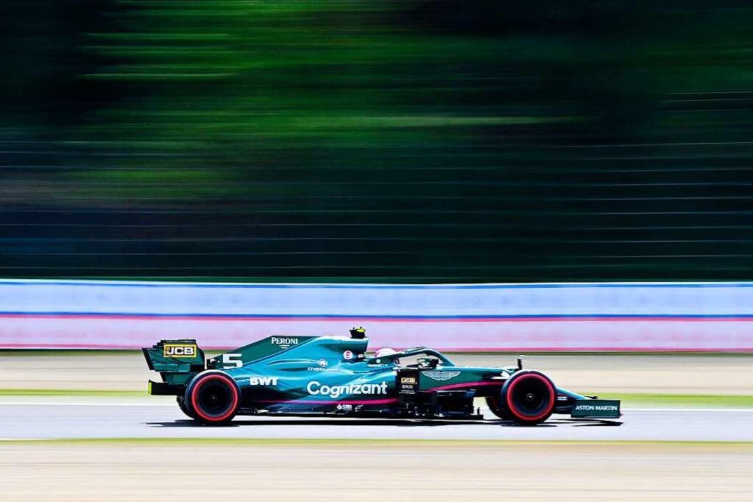 Sieht schnell aus, ist aber im Verglei...ällig: Sebastian Vettels Formel-1-Auto  | Foto: MIGUEL MEDINA (AFP)