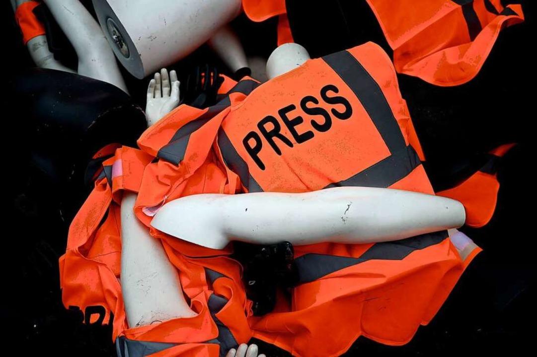 Immer wieder kommt es zu Angriffen auf Journalisten – auch in Deutschland.  | Foto: PHILIPPE LOPEZ (AFP)