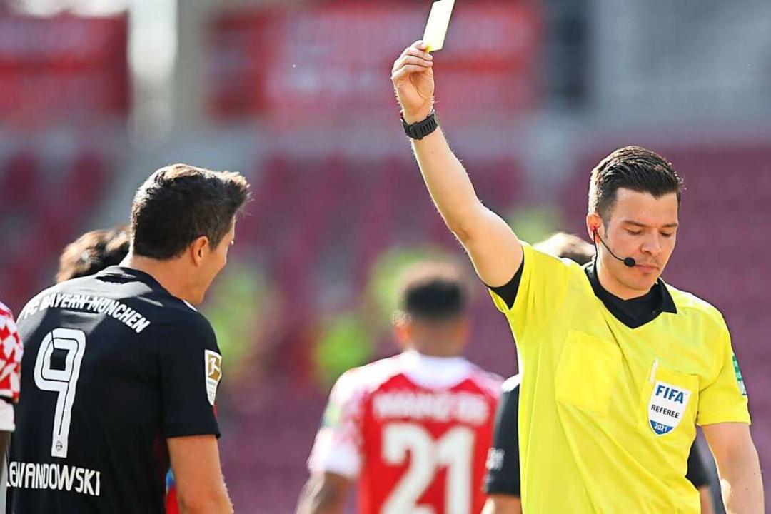 Nichts zu jubeln für Robert Lewandowsk...yern: Die Münchner verlieren in Mainz.  | Foto: Tom Weller (dpa)
