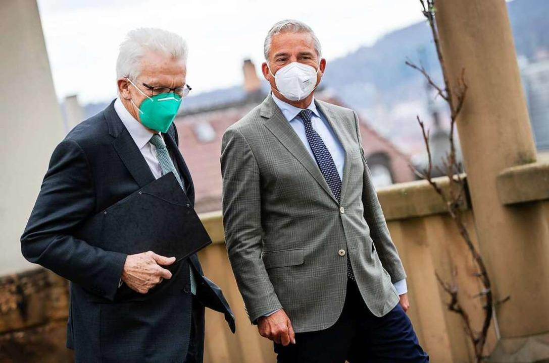 Ministerpräsident Winfried Kretschmann und Innenminister Thomas Strobl.  | Foto: Christoph Schmidt (dpa)