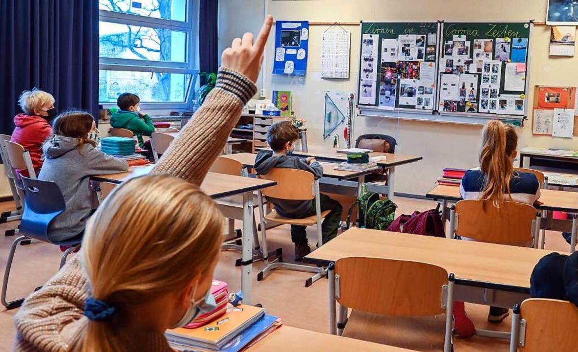 Es sind auch die alltäglichen Dinge im... vergnügt in die Schule kommen können.  | Foto: Patrick Pleul (dpa)