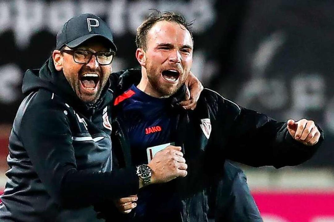 Fabio Viteritti (rechts) mit Claus-Die...iegen sie 2018 in die dritte Liga auf.    Foto: Christian Schroedter, via www.imago-images.de