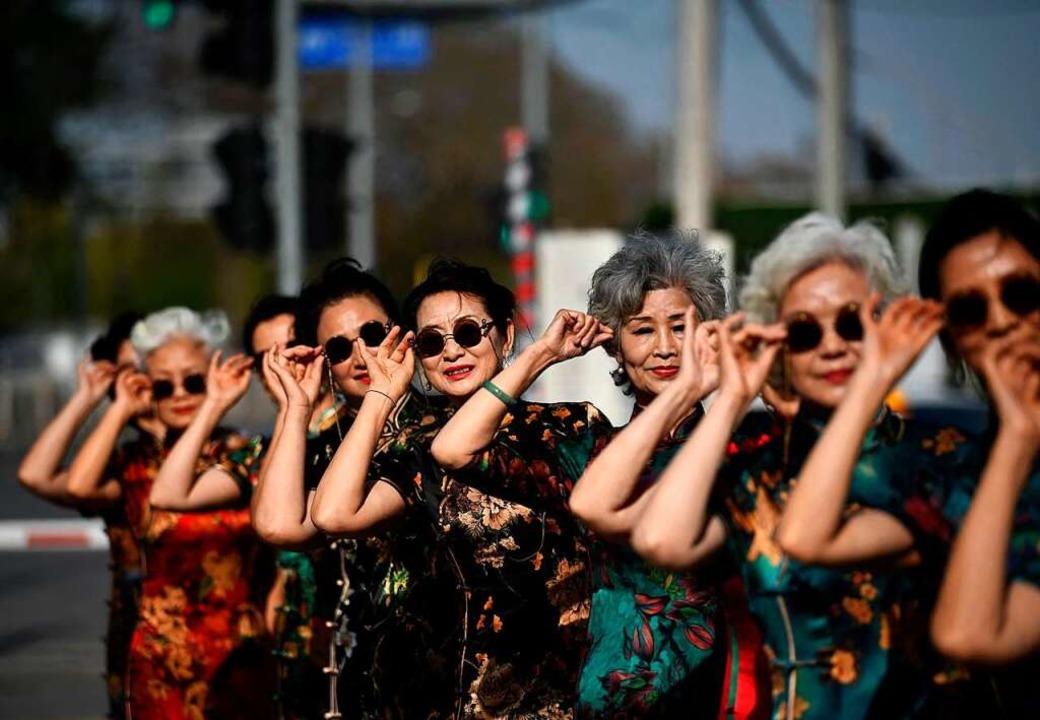 Die chinesische Wirtschaft wird rasant...u sehen sind, machen das beste daraus.  | Foto: NOEL CELIS (AFP)