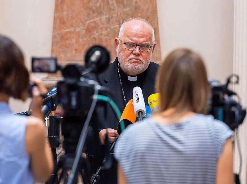 Kardinal Reinhard Marx gibt bekannt, d...t seinen Rücktritt angeboten zu haben.    Foto: Peter Kneffel (dpa)