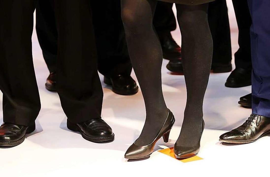 Ab dem vierten Vorstandsposten muss in...Firma mindestens eine Frau dabei sein.  | Foto: Christian Charisius (dpa)
