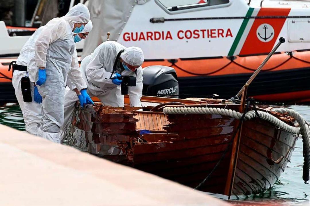Italienische Forensiker begutachten de... zwei deutschen Verdächtigen erlassen.    Foto: Gabriele Strada (dpa)