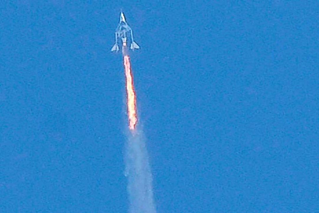 """Die """"VSS Unity"""" auf ihrem ...raum bei 100 Kilometern über der Erde.    Foto: PATRICK T. FALLON (AFP)"""