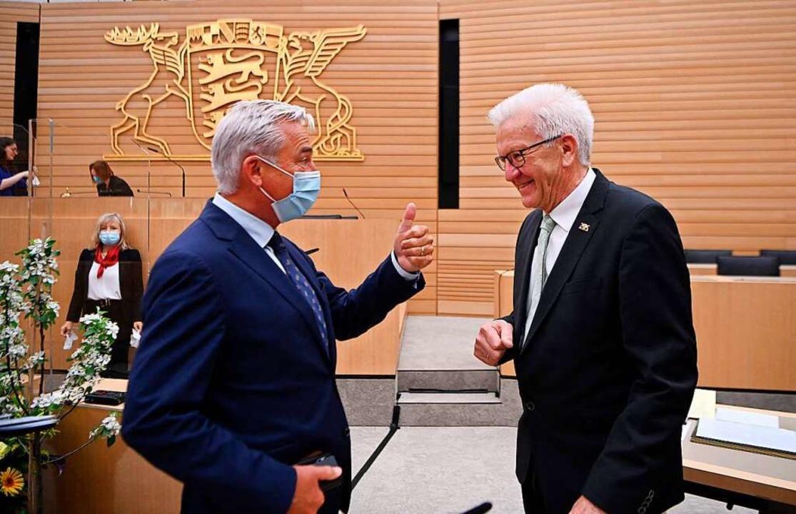 CDU-Vizeregierungschef Thomas Strobl (...Ministerpräsident Winfried Kretschmann  | Foto: MARIJAN MURAT (AFP)