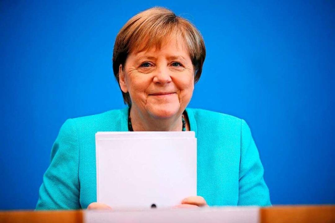 In Sachen Klimaschutz sieht Angela Mer...icht. Aber sie räumt auch Fehler ein.     Foto: HANNIBAL HANSCHKE (AFP)