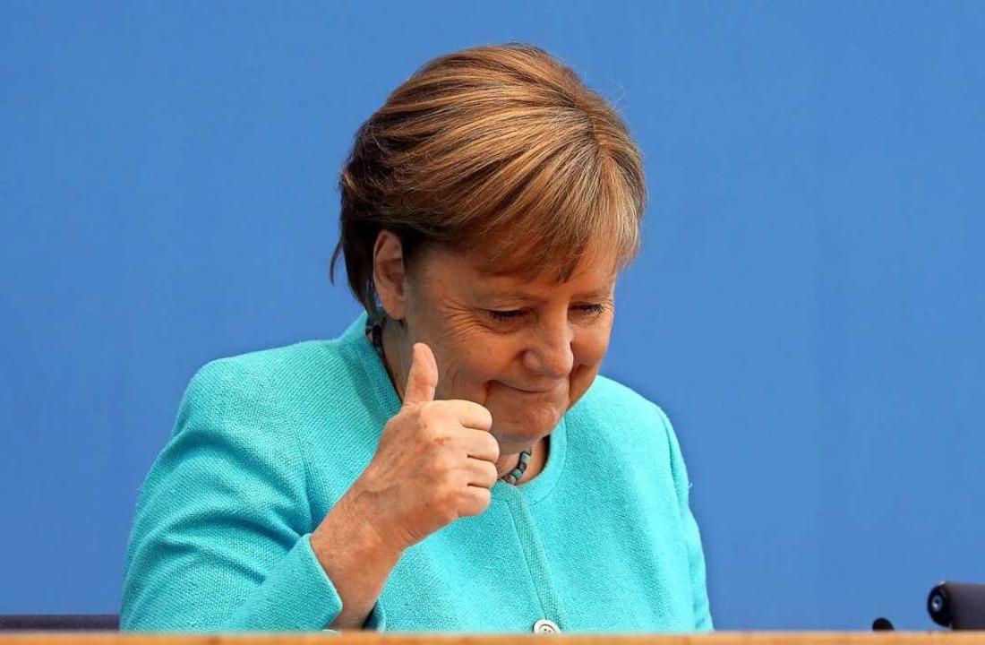 Trockener Humor und geschäftsmäßige Nü...uftritt auf der Bundespressekonferenz.  | Foto: Wolfgang Kumm (dpa)