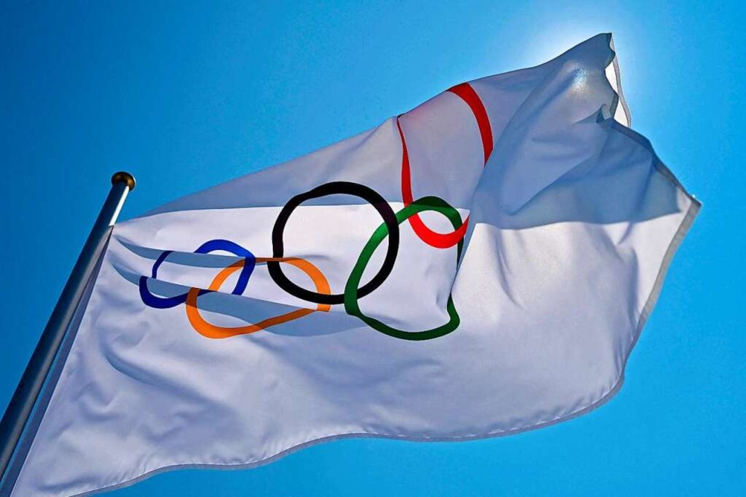Die Olympische Flagge.  | Foto: ANDREJ ISAKOVIC (AFP)