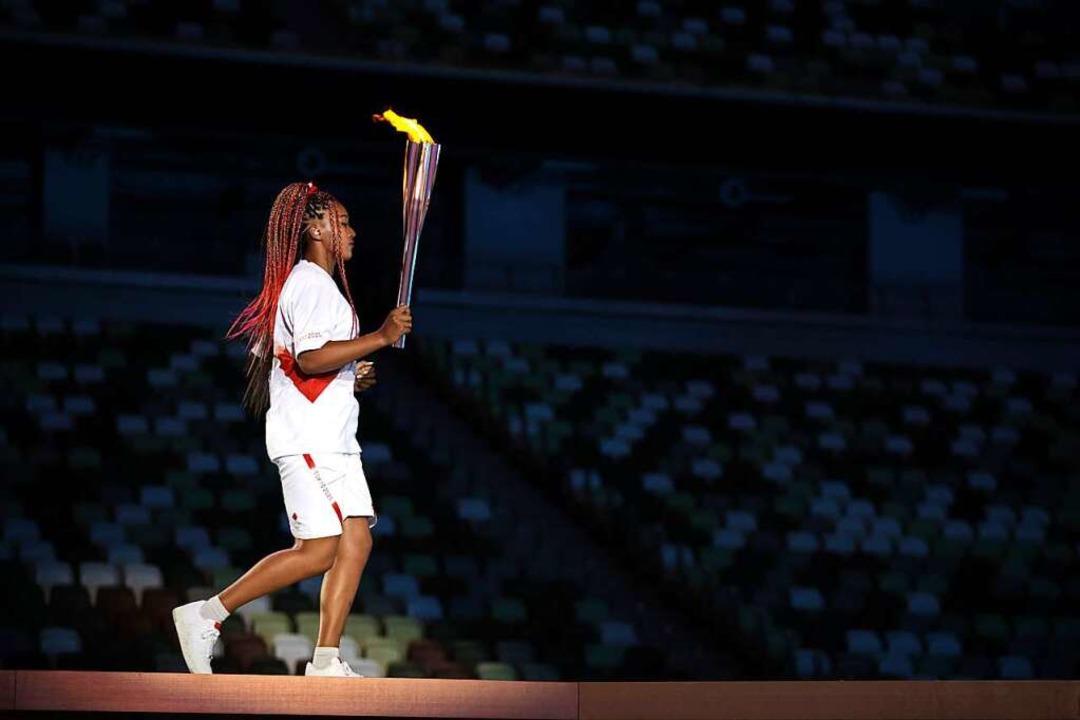 Die japanische Weltklasse-Tennisspiele...Osaka entzündete das olympische Feuer.    Foto: Hannah Mckay (dpa)