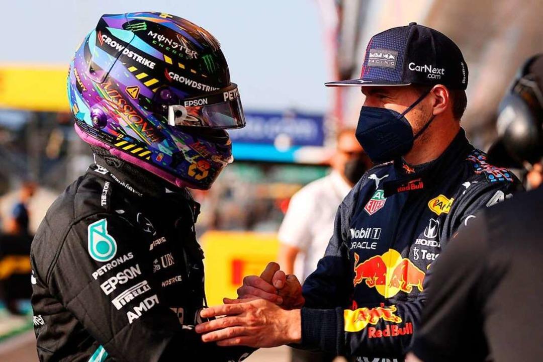 Sind die Differenzen zwischen Lewis Ha...Verstappen nun tatsächlich ausgeräumt?    Foto: LARS BARON (AFP)