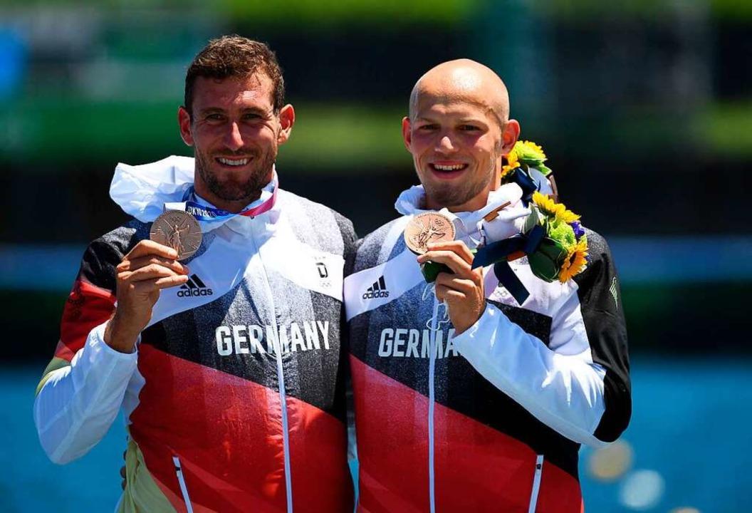 Freude über Bronze  | Foto: PHILIP FONG (AFP)