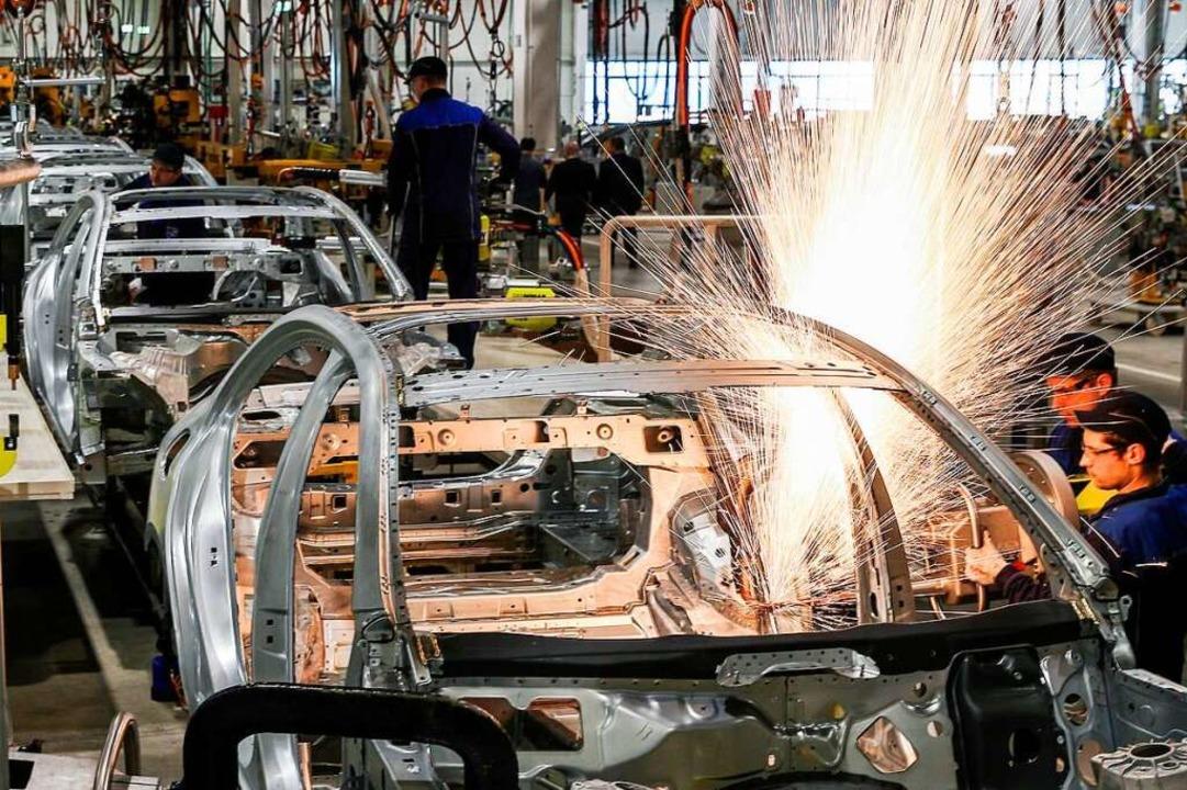 Es läuft wieder in der Autoindustrie.  | Foto: Sergei Bobylev (dpa)