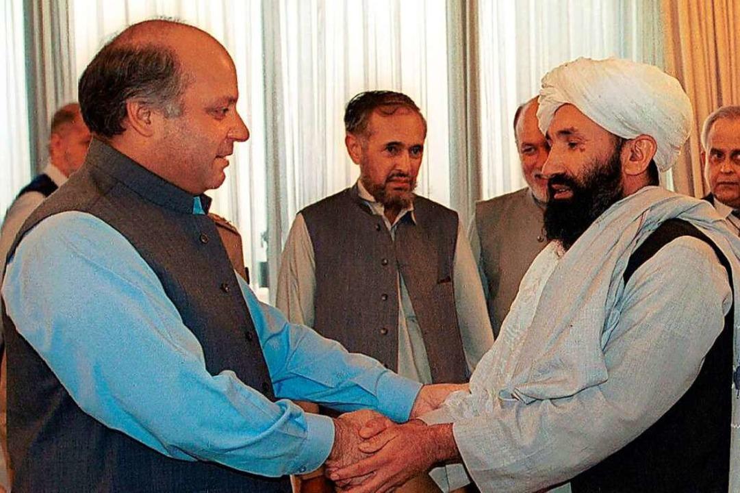 25. August 1999: Mullah Mohammed Hassa...amaligen Premierminister von Pakistan.  | Foto: B.K. Bangash (dpa)