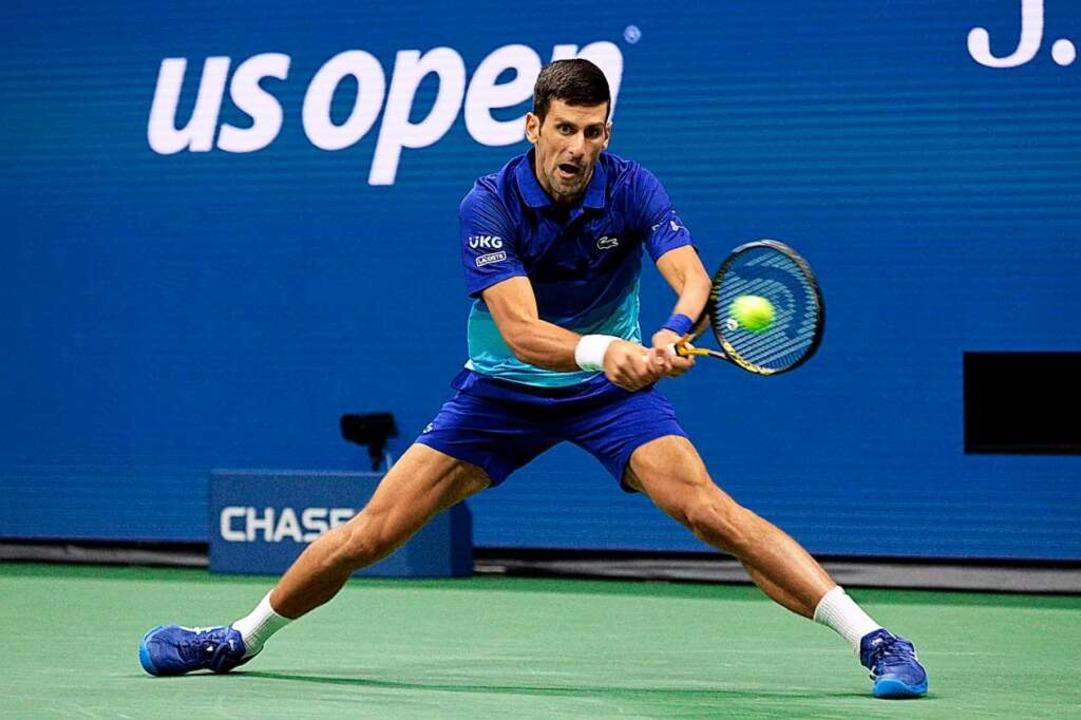 Novak Djokovic kämpft sich zum Sieg.  | Foto: KENA BETANCUR (AFP)