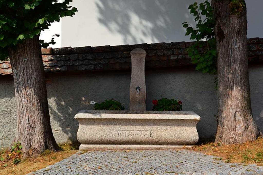 Brunnen an der alten Dorfkirche in Menzenschwand  | Foto: Christiane Sahli