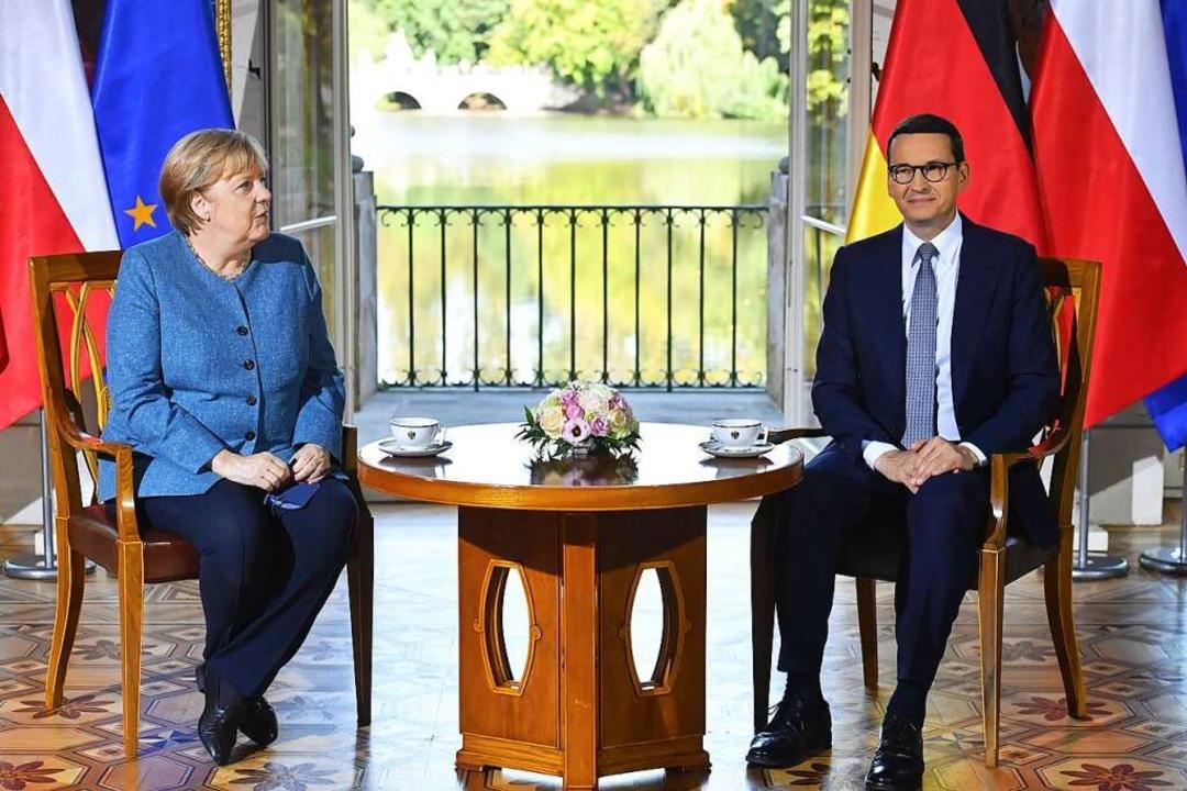 Bundeskanzlerin Angela Merkel (CDU) un...orawiecki, Ministerpräsident von Polen    Foto: Piotr Nowak (dpa)