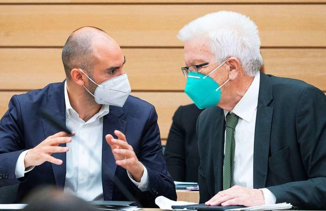 Danyal Bayaz (l), Finanzminister, und ...inisterpräsident von Baden-Württemberg  | Foto: Marijan Murat (dpa)