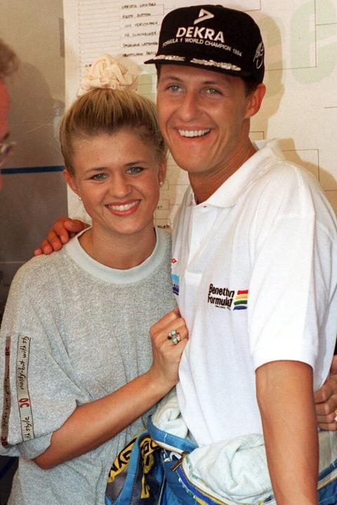Michael Schumacher und seine Frau Cori...ember 1995 im portugiesischen Estoril.  | Foto: Harry Melchert (dpa)