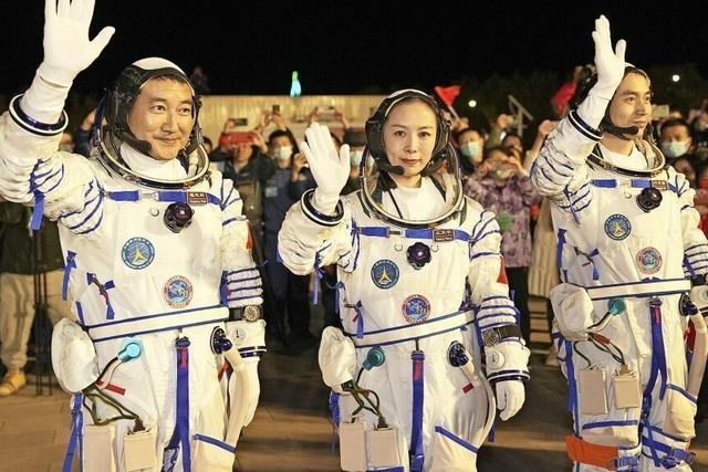 Eine Chinesin greift nach den Sternen